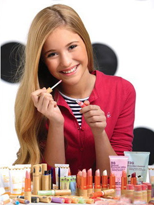 Young girl applying makeup form Wall-mart's geoGirl line.