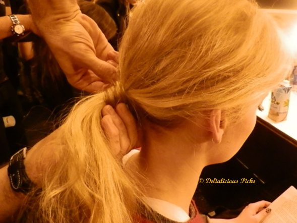 Stylist Zahir Ziani didn't use any rubber bands to hold the base of the hair in place. Instead, he used the model's own hair, which was secured with bobby pins.