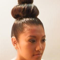 The hair, styled by Prive Salon, was high with multiple structured buns.