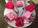 Birthday Girl shirts on display.