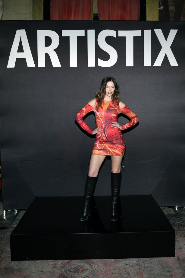 Look #14 Janine- Hand Painted Harvest Trucker Vest; Jack-Booted Military Khakis (Photo by Lars Niki/Getty Images for ARTISTIX)