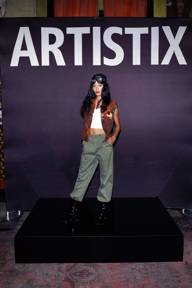 Look # 14 Janine- Hand Painted Harvest Trucker Vest; Jack-Booted Military Khakis  (Photo by Lars Niki/Getty Images for ARTISTIX)