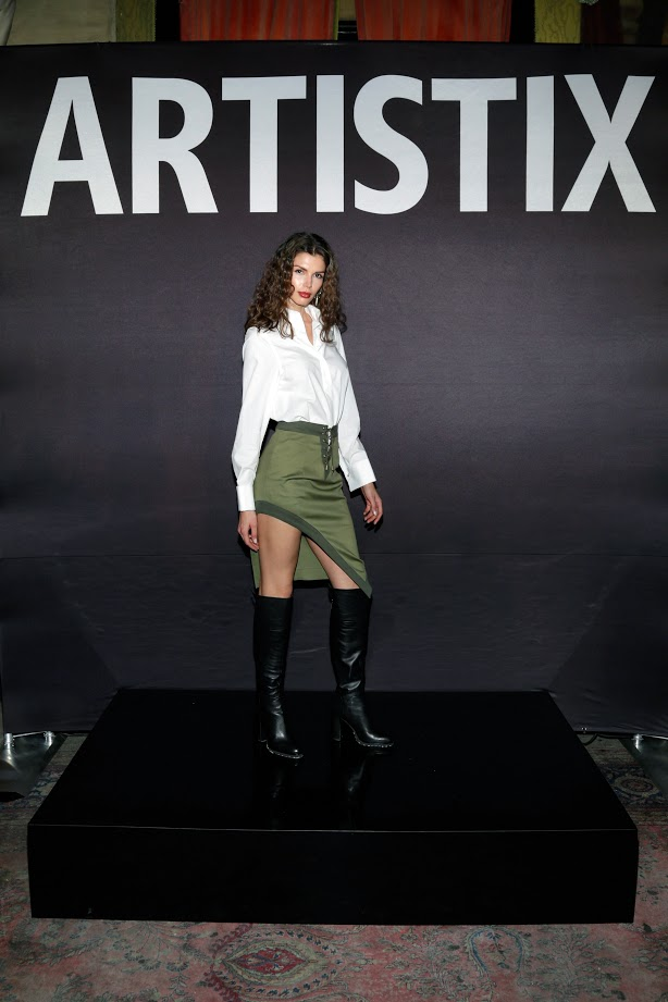 Look # 10 Alejandra- White ARTISTIX Blouse; Asymmetrical Military Skirt (Photo by Lars Niki/Getty Images for ARTISTIX)